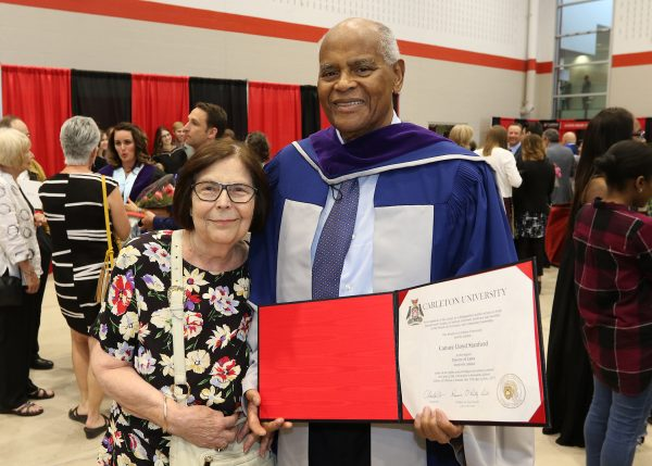 Lloyd with his wife, Anita DesRosier, after being awarded with an honorary Doctor of Laws from Carleton at the 2017 Spring Convocation.